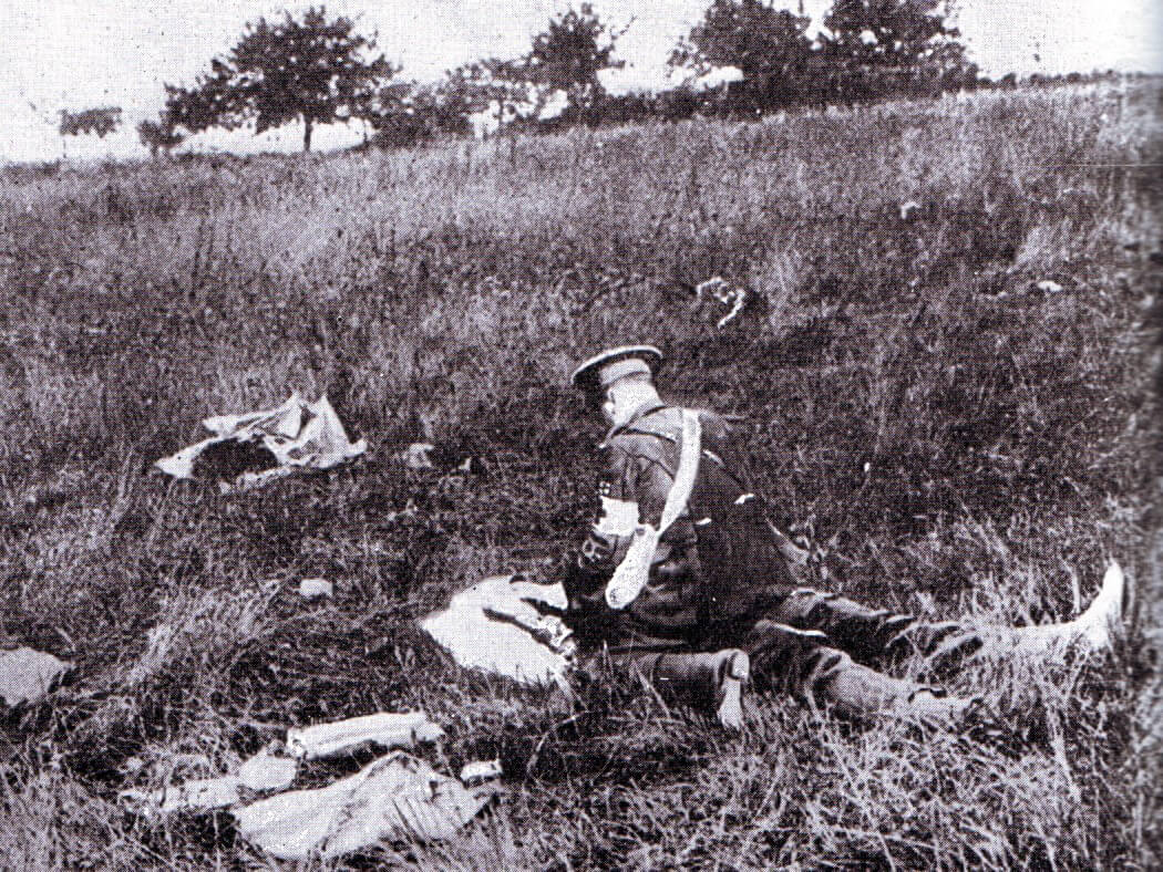 A British medical orderly attending a casualty on the Aisne Battlefield