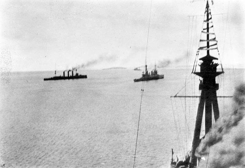 HMS Kent, Glasgow and Inflexible leaving Port Stanley in pursuit of the German squadron: photograph taken by Paymaster Sub-Lieutenant Duckworth RN from HMS Invincible at the beginning of the Battle of the Falkland Islands on 8th December 1914 in the First World War