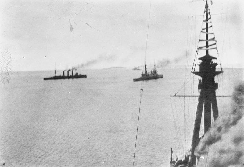 HMS Kent, Glasgow and Inflexible. Photograph taken by Paymaster Sub-Lieutenant Duckworth RN from HMS Invincible at the beginning of the Battle of the Falkland Islands on 8th December 1914.