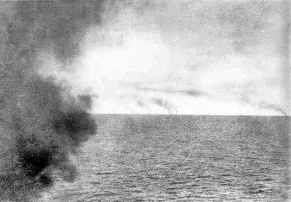 Photograph taken from the masthead of HMS Invincible by Paymaster Sub-Lieutenant Duckworth RN as the chase began in the Battle of the Falkland Islands on 8th December 1914 in the First World War. The smoke from the German ships can be seen on the horizon