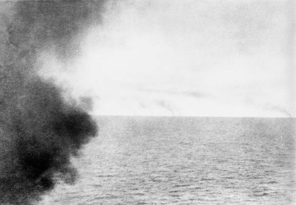 Photograph taken from the masthead of HMS Invincible by Paymaster Sub-Lieutenant Duckworth RN as the chase began in the Battle of the Falkland Islands on 8th December 1914. The smoke from the German ships can be seen on the horizon