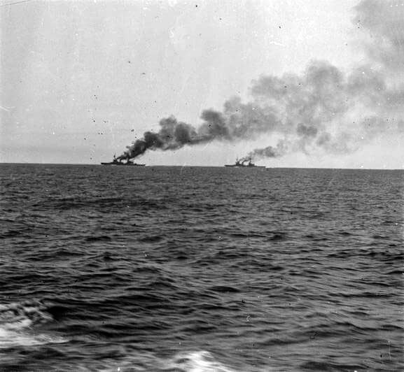 HMS Inflexible and Invincible seen from HMS Kent during the pursuit of the German squadron in the Battle of the Falkland Islands on 8th December 1914 in the First World War