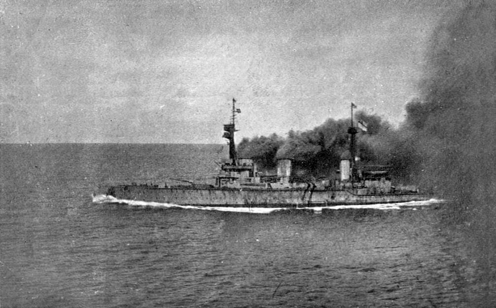 HMS Invincible under way and giving off clouds of black smoke at the beginning of the Battle of the Falkland Islands on 8th December 1914 in the First World War