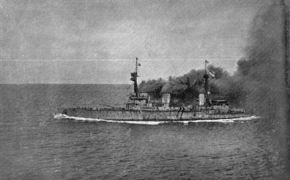 HMS Invincible under way and giving off clouds of black smoke at the beginning of the Battle of the Falkland Islands on 8th December 1914