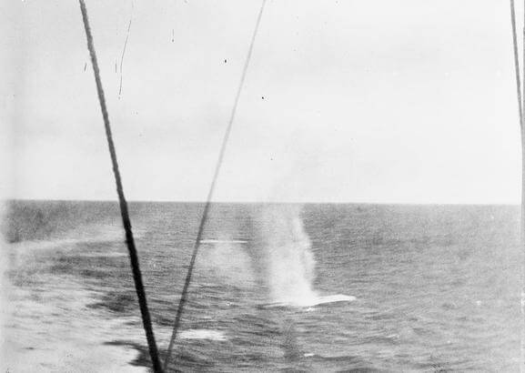 Shots fired by SMS Scharnhorst landing in the sea behind HMS Invincible during the Battle of the Falkland Islands on 8th December 1914. Photograph taken by Paymaster Sub-Lieutenant Duckworth RN from HMS Invincible