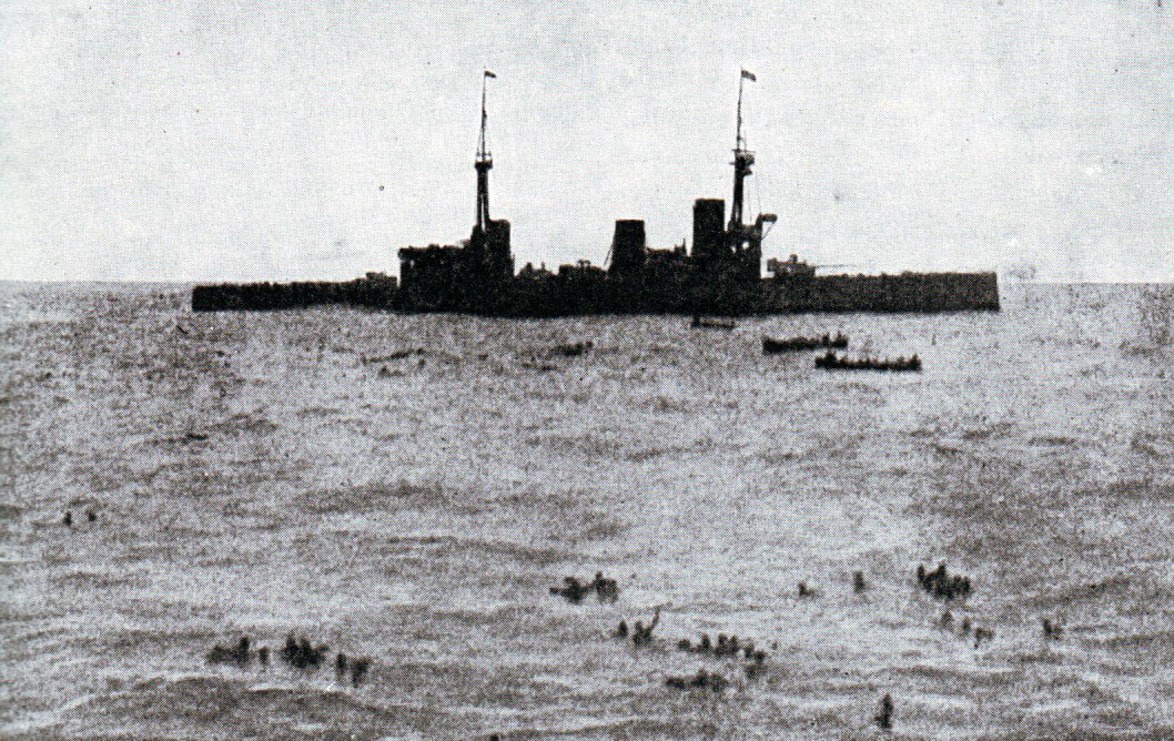 HMS Inflexible picking up survivors from SMS Gneisenau at the end of the Battle of the Falkland Islands on 8th December 1914 in the First World War: photograph taken by Paymaster Sub-Lieutenant Duckworth RN from HMS Invincible