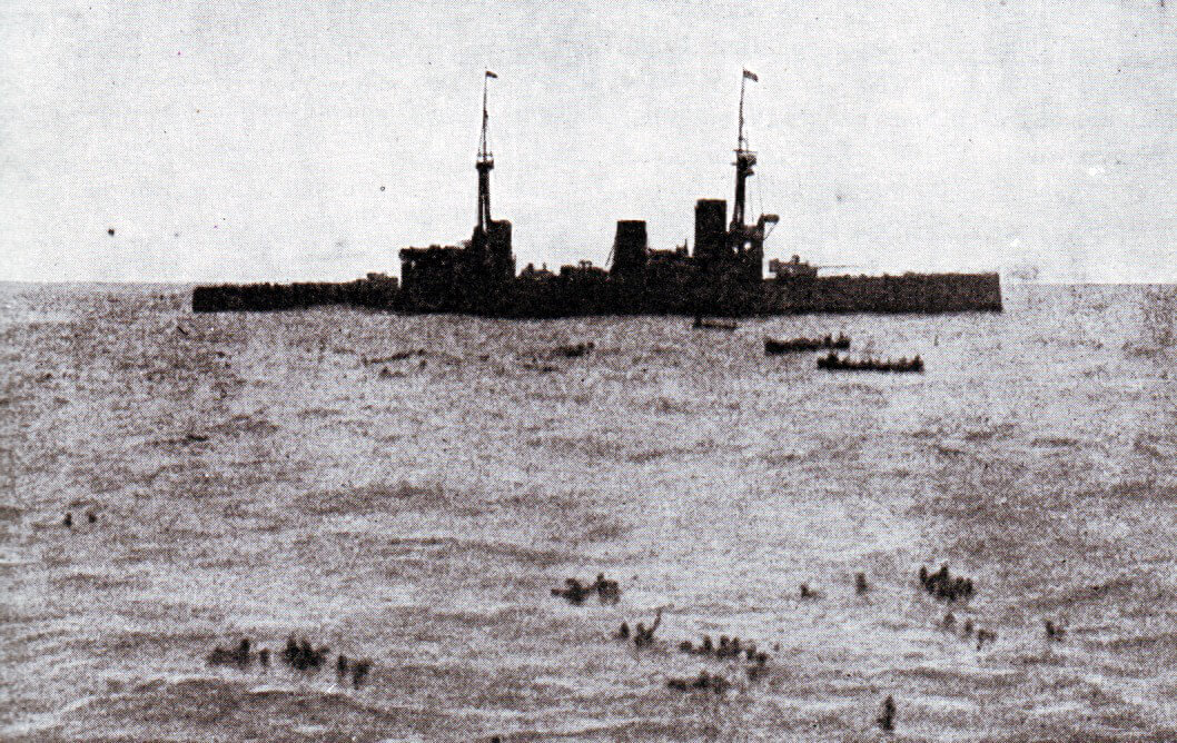 HMS Inflexible picking up survivors from SMS Gneisenau at the end of the Battle of the Falkland Islands on 8th December 1914. Photograph taken by Paymaster Sub-Lieutenant Duckworth RN from HMS Invincible