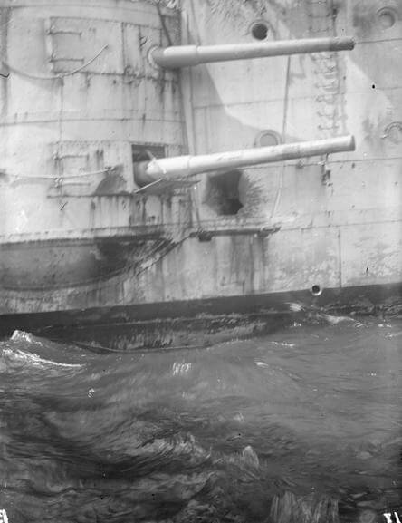 Damage to the hull of HMS Kent caused by shell-fire from SMS Nürnberg during the Battle of the Falkland Islands on 8th December 1914
