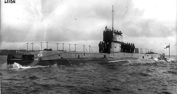 British submarine HMS E4, one of the vessels from 8th 'Oversea' Submarine Flotilla, based in Harwich, that routinely patrolled in the Heligoland Bight and acted as 'bait' in the Heligoland Bight operation on 28th August 1914. E4 was commanded by Lieutenant Commander Leir (see Anecdotes). She rescued the crew of HMS Dolphin's whaler.