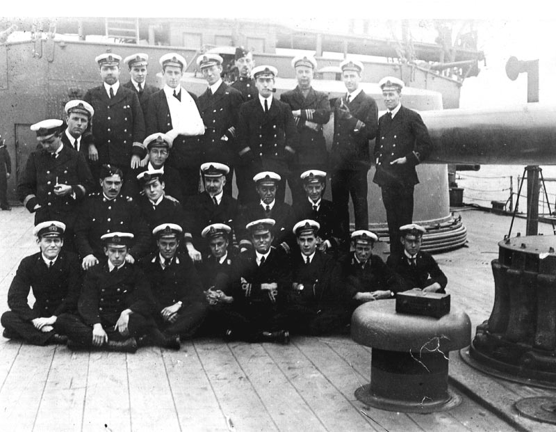 Photograph of some of the officers of HMS Good Hope taken in the Falkland Islands in October 1914. None of these officers survived the destruction of the Good Hope at the Battle of Coronel on 1st November 1914 in the First World War. The three Canadian midshipmen are third, fourth and seventh in the front row (Mid. A. W. Silver, RCN; Mid. M. Cann, RCN; Mid. W. A. Palmer, RCN).