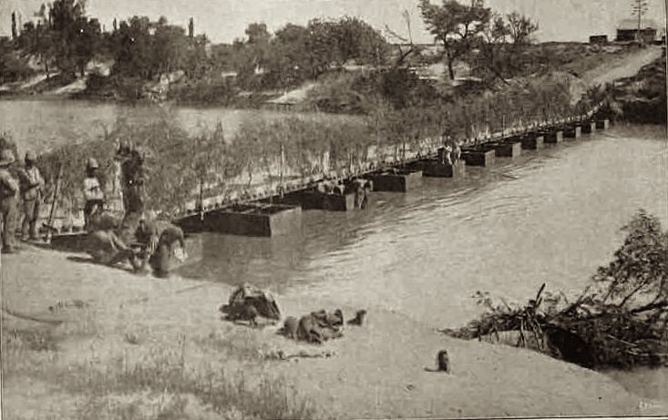 The pontoon bridge built over the Modder River by the Royal Engineers to replace the railway bridge demolished by the Boers