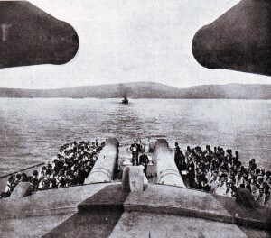 The 15 inch guns of HMS Queen Elizabeth with the coast of the Dardanelles in the distance.  Queen Elizabeth was the most powerful battleship in the British Fleet bombarding the Gallipoli Peninsular during the 1915 campaign