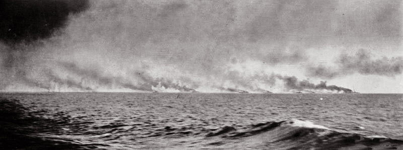 Second of a sequence of photographs of the opening stages of the Battle Cruiser action at the Battle of Jutland 31st May 1916 taken at 3.30pm by Paymaster Lieutenant Duckworth from HMS Birmingham. The vertical white clouds are spouts of water put up by exploding heavy calibre shells.
