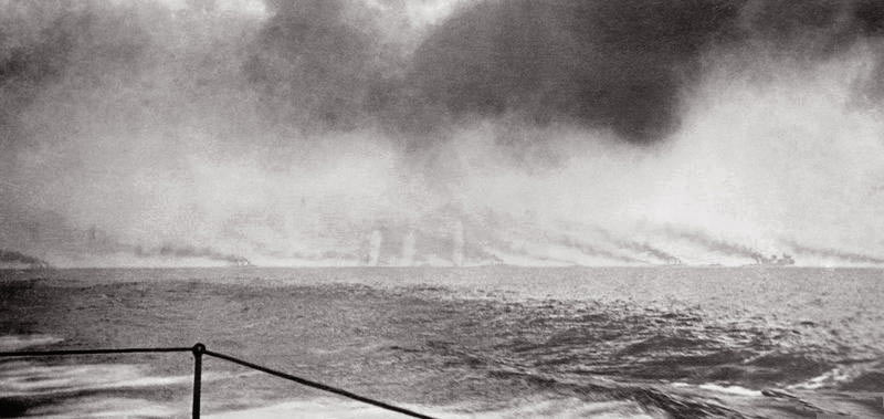 Fifth of a sequence of photographs of the opening stages of the Battle Cruiser action at the Battle of Jutland 31st May 1916 taken at 4pm by Paymaster Lieutenant Duckworth from HMS Birmingham. The vertical white clouds are spouts of water put up by exploding heavy calibre shells.