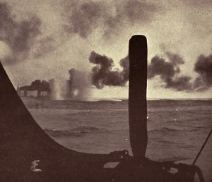 Third of a series of photographs taken from a British destroyer at the Battle of Jutland on 31st May 1916 showing salvos of German shells landing short of HMS Lion: contemporary photograph taken from a British destroyer