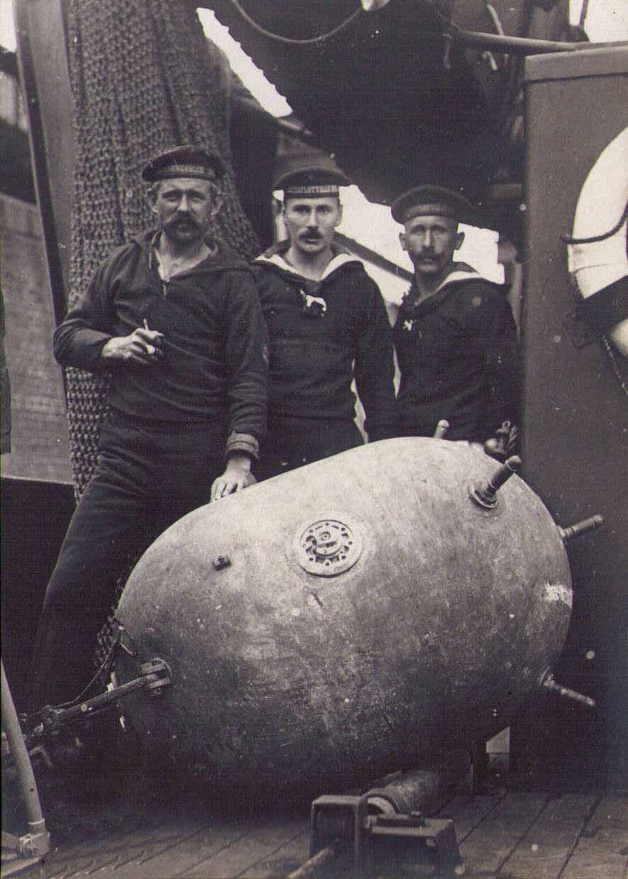 German sailors preparing a mine for launching on a minelayer