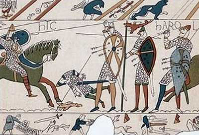 King Harold is shown plucking the arrow from his eye: a scene from the Bayeux Tapestry: click here to buy this picture