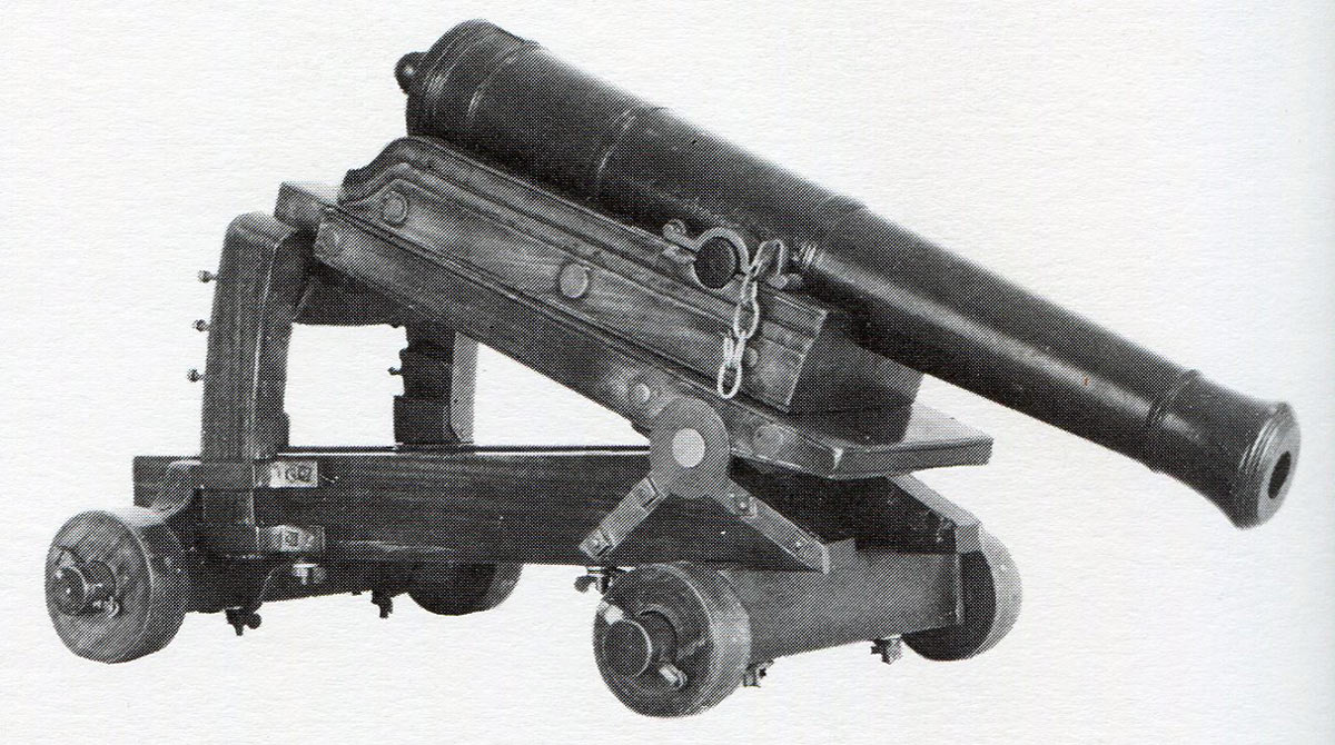 24-pounder cannon on a 'depressing gun carriage' devised by Lieutenant Koehler, adc to General Eliott, which enabled a gun to be fired from high on the Rock down into the Spanish siege works on the Isthmus:: the Great Siege of Gibraltar from 1779 to 1783 during the American Revolutionary War