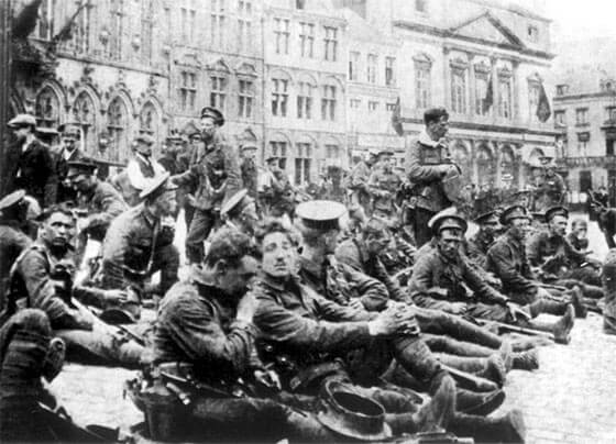 A Company, 4th Royal Fusiliers in the market square of Mons on 22nd August 1914, the day before the Battle of Mons. Soon after this photograph was taken the battalion moved up to the Mons Canal line at Nimy