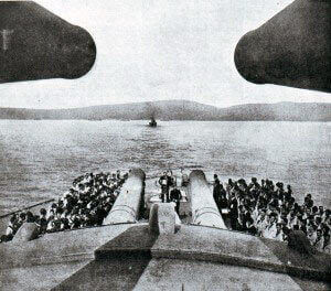 The 15 inch guns of HMS Queen Elizabeth with the coast of the Dardanelles in the distance: Gallipoli campaign Part I: the Naval Bombardment, March 1915 in the First World War