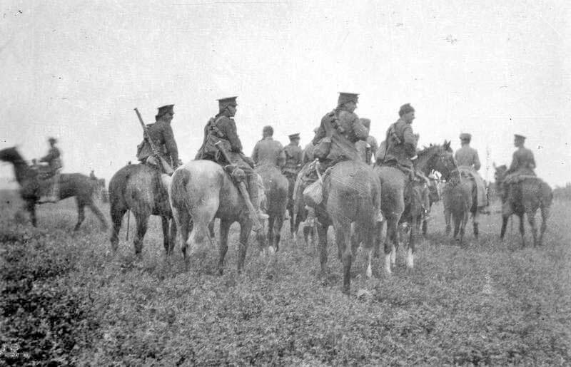Queen's Bays after the action, with German prisoners from the Death's Head Hussars: Battle of Néry on 1st September 1914 in the First World War