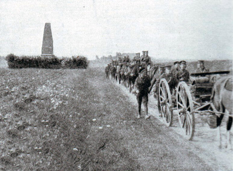 British transport passing the memorial to the Battle of Malplaquet, fought by the Duke of Marlborough on 11th September 1709 to the south of Mons, during the retreat: Battle of Mons on 23rd August 1914 in the First World War