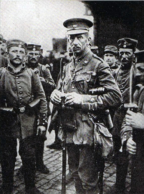 Major C.A.L. Yate, awarded the Victoria Cross for his conduct at the Battle of Le Cateau. Photograph taken of Major Yate with German soldiers, after his capture: Battle of Le Cateau on 26th August 1914 in the First World War