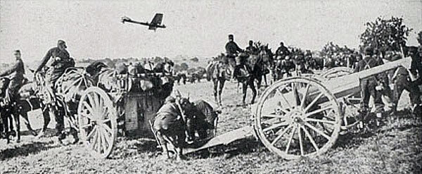 French 75mm field gun, with aircraft in the background, during the Battle of the Marne, fought from 6th to 9th September 1914, during the First World War