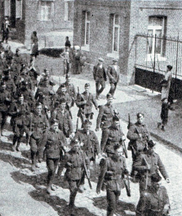 1st Scottish Rifles (Cameronians) marching through a French town: First Day of the Retreat from Mons and the Battle around Elouges and Audregnies, fought on 24th August 1914 in the First World War