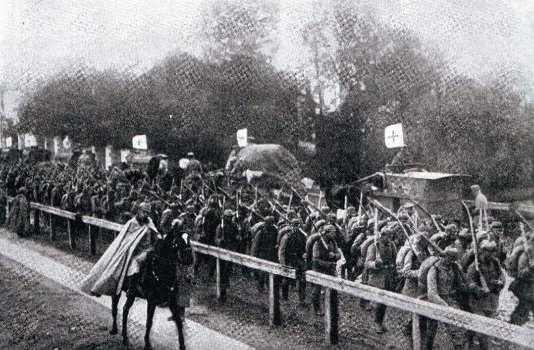Advancing German infantry pass a Red Cross column:Battle of the Marne, fought from 6th to 9th September 1914, during the First World War