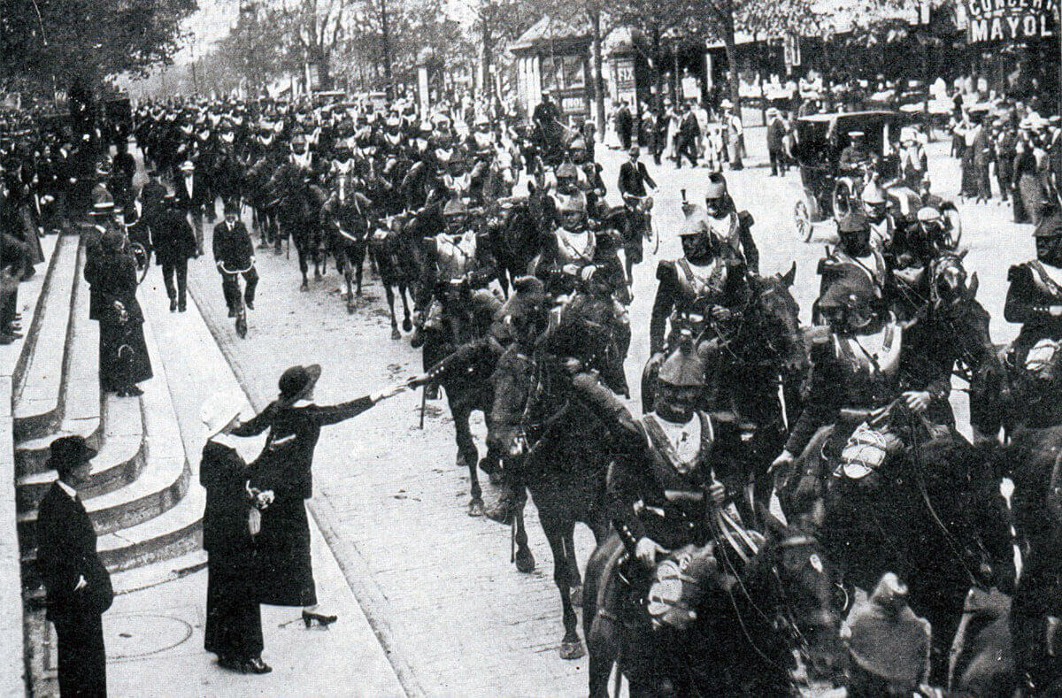 French cuirassiers passing through Paris in 1914: the girl giving the flower is said to have been British:Battle of the Marne, fought from 6th to 9th September 1914, during the First World War