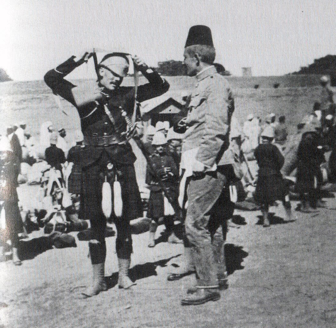 Cameron Highlanders officer and an officer of an Egyptian Regiment in the desert: Battle of Atbara on 8th April 1898 in the Sudanese War