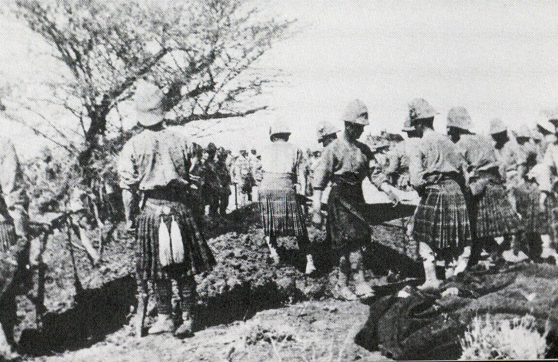 Seaforth and Cameron Highlanders burying their dead after the Battle of Atbara on 8th April 1898 in the Sudanese War