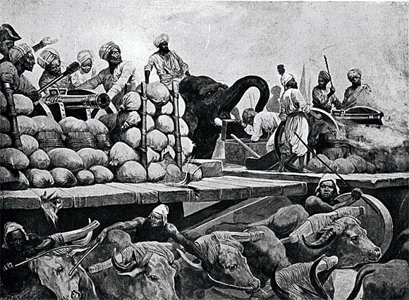 Siraj-ud-Daulah's guns on wooden trucks pulled by oxen and pushed by elephants at the Battle of Plassey on 23rd June 1757 in the Anglo-French Wars in India: picture by Richard Caton Woodville
