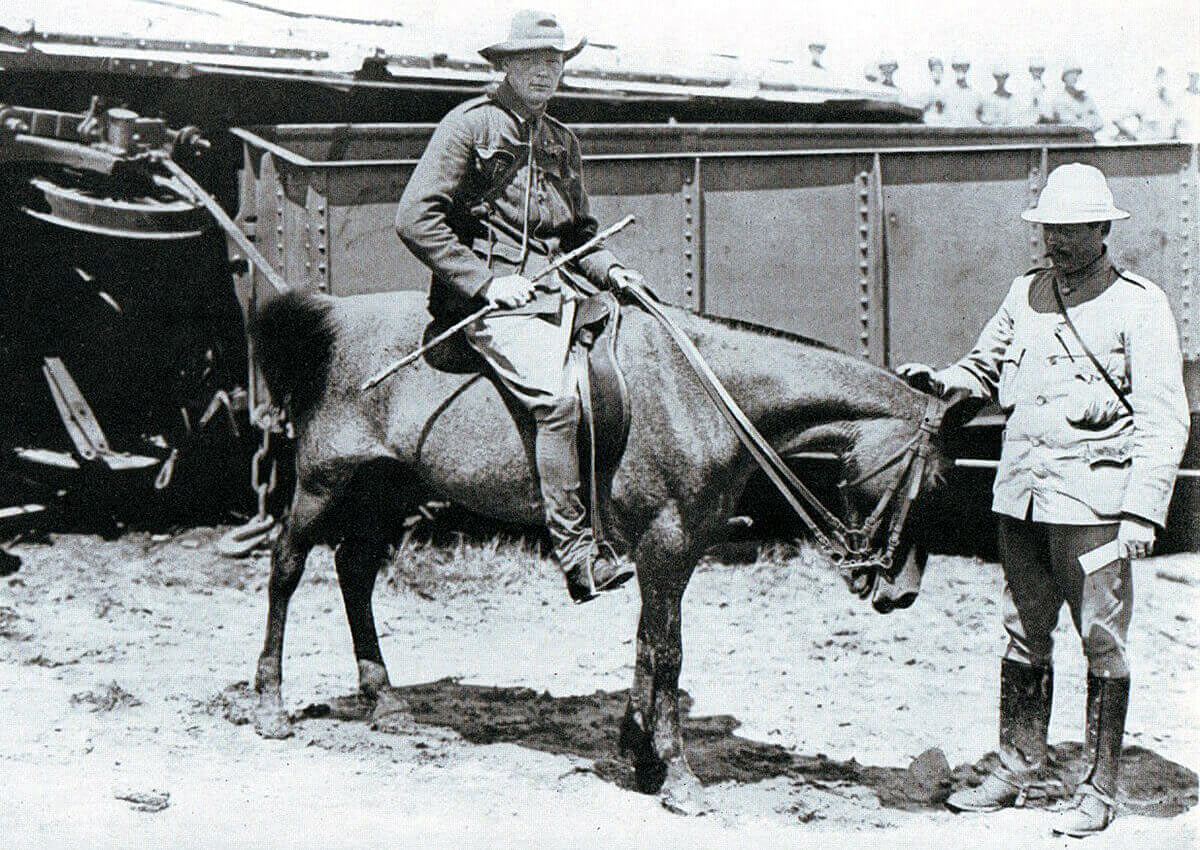 Winston Churchill (on the pony) by the wrecked railway trucks of the Armoured Train at Chieveley on 15th November 1899