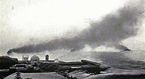 Commencement of the Battle of Jutland on 31st May 1916. British battle cruisers are in the distance behind the smoke line: contemporary photograph taken from the light cruiser HMS Champion