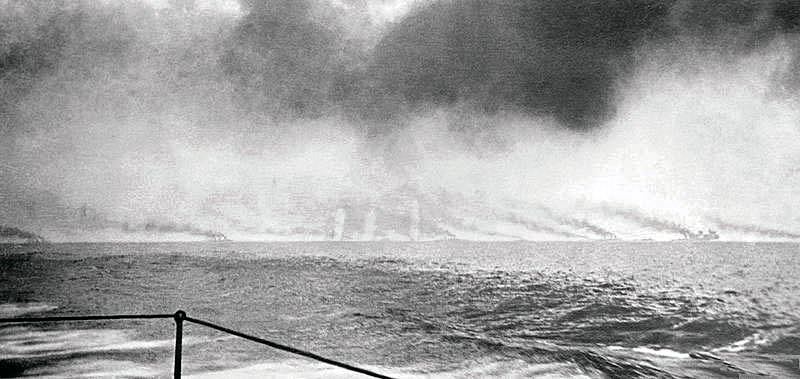 Fifth of a sequence of photographs of the opening stages of the Battle Cruiser action at the Battle of Jutland 31st May 1916 taken at 4pm by Paymaster Lieutenant Duckworth from HMS Birmingham. The vertical white clouds are spouts of water put up by exploding heavy calibre shells