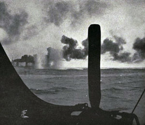 Third of a series of photographs taken from a British destroyer at the Battle of Jutland on 31st May 1916 showing salvos of German shells landing short of HMS Lion
