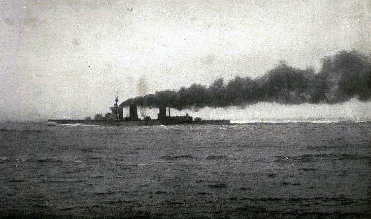 Flames shooting out of HMS Lion's Q Turret after being hit by German shells: contemporary photograph taken from a British destroyer