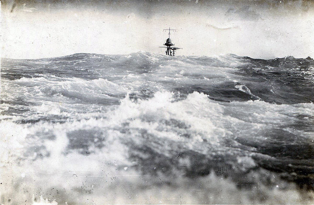 View of next in line battleship in heavy sea taken from HMS Barham