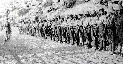 1st Royal Munster Fusiliers holding a roll call 18 days after the landing at V Beach Cape Helles on 25th April 1915: present were 5 officer and 372 men out of the battalion's original strength of 25 officers and 900 men