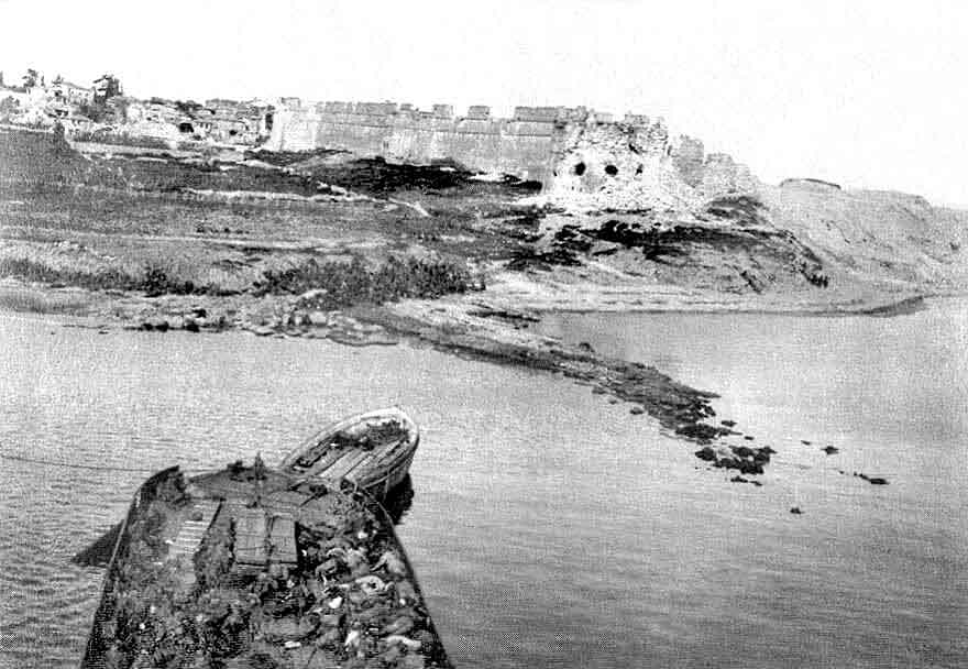 Fort of Sedd el Bahr at the eastern end of V Beach Cape Helles Gallipoli seen from the bridge of the River Clyde with the bow machine gun position in the foreground