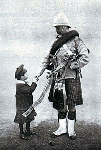 Pipe Major David Laing of 1st Scots Guards saying 'Goodbye' to his kilted son before leaving for South Africa: Battle of Modder River on 28th November 1899 in the Boer War