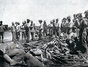 British troops clearing the battlefield of bodies and abandoned weapons after the Battle of Modder River on 28th November 1899 in the Boer War