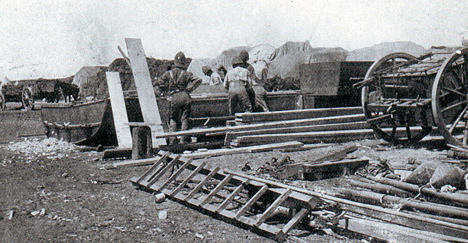 Royal Engineers preparing pontoon bridges to cross the Modder River after the Battle of Modder River on 28th November 1899 in the Boer War, the railway bridge having been destroyed by the Boers