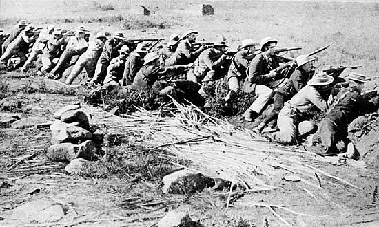 Boers lining a trench of the type used at the Battle of Magersfontein on 11th December 1899 in the Boer War