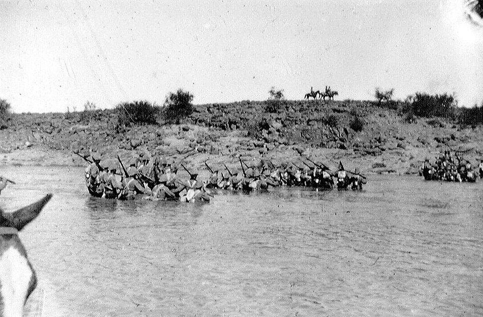 Canadian infantry crossing Paardeberg Drift at the Battle of Paardeberg on 27th February 1900 in the Great Boer War