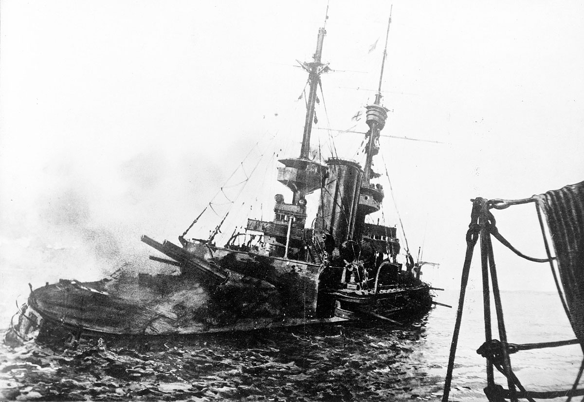 HMS Irresistible sinking after striking a Turkish mine on 18th March 1915: Gallipoli campaign Part I: the Naval Bombardment, March 1915 in the First World War: photograph taken from HMS Nelson