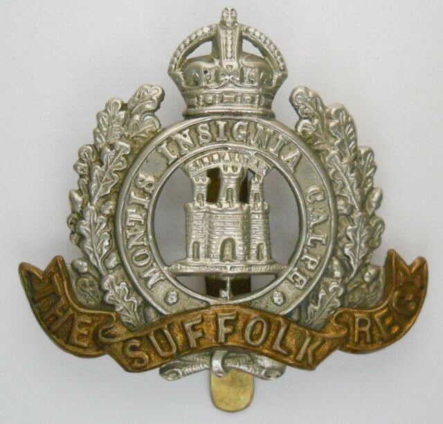 Badge of the Suffolk Regiment, previously 12th Regiment, with the 'Castle and Key' and the motto 'Montis Insignia Calpe' after the Great Siege of Gibraltar from 1779 to 1783 during the American Revolutionary War